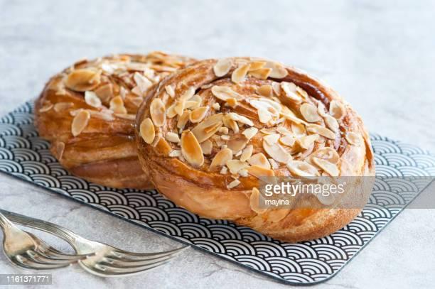cinnamon danish - sweet bun stock pictures, royalty-free photos & images
