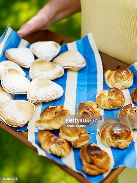 Cinnamon rolls on a tray.