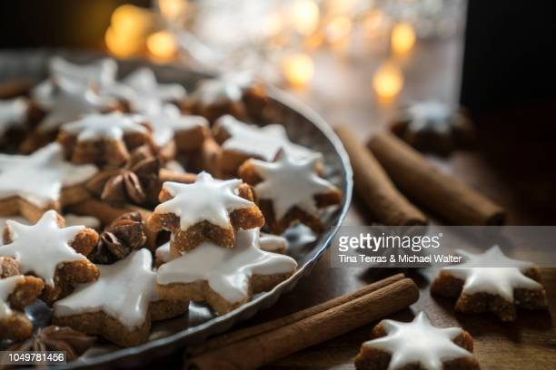 cinnamon star cookies (zimtsterne) - christmas cake stock photos and pictures