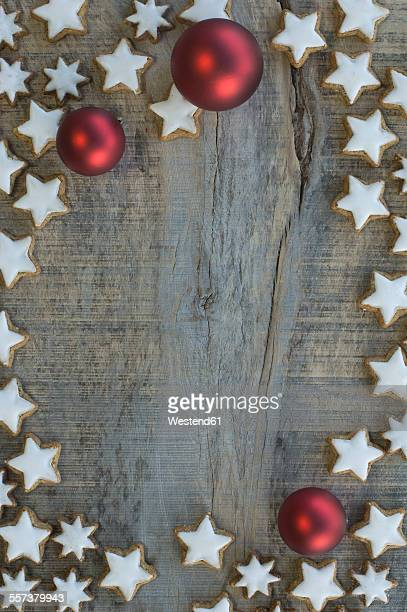 Cinnamon stars and red Christmas baubles