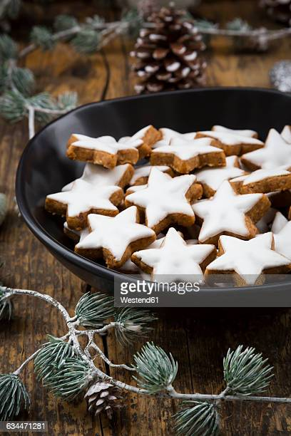 Cinnamon stars in bowl and christmas decoration
