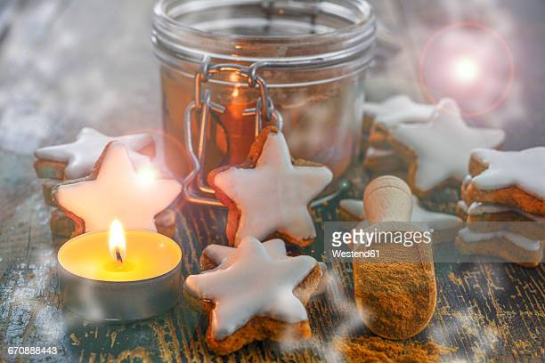 Cinnamon stars, tea light and cinnamon powder