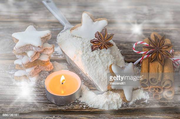 Cinnamon stars, tea light, flour and spices