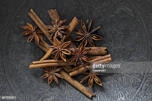 Cinnamon sticks and star anise on metal plate