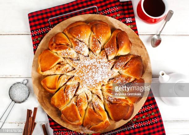 cinnamon sweet brioche. yeast pie. - brioche stock pictures, royalty-free photos & images