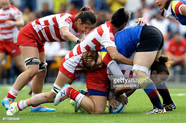 Cinthia Cristaldo of Paraguay is tackled by Catalina Arango of Colombia during the women's rugby final of the XVIII Bolivarian Games 2017 in Santa...