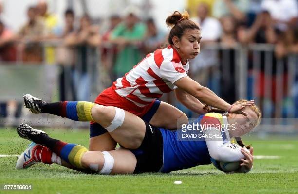 Cinthia Cristaldo of Paraguay tackles Catalina Arango of Colombia in the women's rugby final match during the XVIII Bolivarian Games 2017 in Santa...