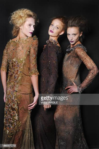 Cintia Dicker Alicia Kuczman and Izabel Hickman pose during the Lino Villaventura show at the Sao Paulo Fashion Week Winter 2014 on October 31 2013...