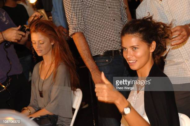 Cintia Dicker and Adriana Lima during Olympus Fashion Week Spring 2006 Luca Luca Front Row and Backstage at Bryant Park in New York City New York...