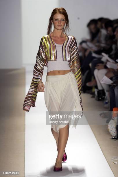 Cintia Dicker wearing Atil Kutoglu Spring 2006 during Olympus Fashion Week Spring 2006 Atil Kutoglu Runway at Bryant Park in New York City New York...