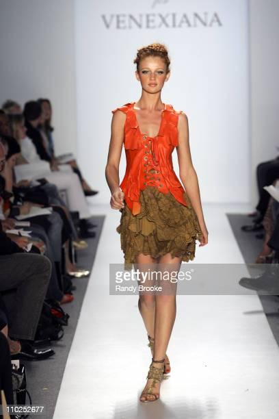 Cintia Dicker wearing Venexiana Spring 2006 during Olympus Fashion Week Spring 2006 Venexiana Runway at Bryant Park in New York City New York United...