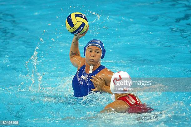 Cinzia Ragusa of Italy looks to pass over the defense of Teng Fei of China in the women's classification 5th6th place match at the Ying Tung...