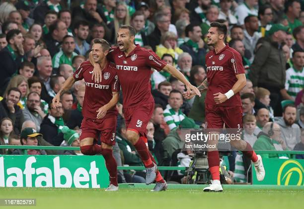 Ciprian Deac of CFR Cluj celebrates after he scores the opening goal during the UEFA Champions League, third qualifying round, second leg match...