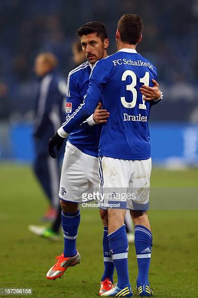 Ciprian Marica and Julian Draxler of Schalke look dejected after the Bundesliga match between FC Schalke 04 and Borussia Moenchengladbach at...