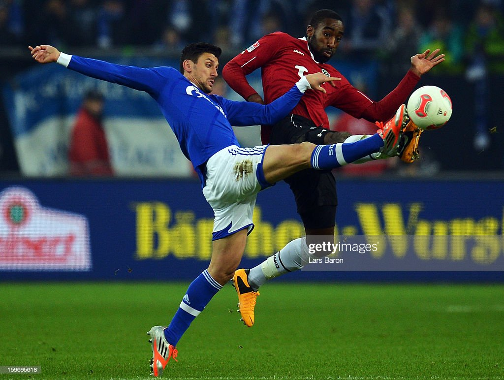 Ciprian Marica of Schalke is challenged by Johan Djourou of Hannover during the Bundesliga match between FC Schalke 04 and Hannover 96 at Veltins-Arena on January 18, 2013 in Gelsenkirchen, Germany.
