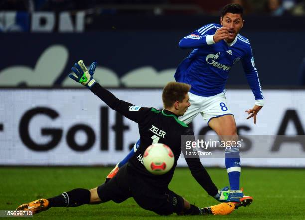 Ciprian Marica of Schalke scores his teams fourth goal during the Bundesliga match between FC Schalke 04 and Hannover 96 at Veltins-Arena on January...