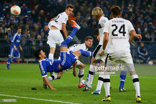 Ciprian Marica of Schalke scores the second goal during the DFB Cup second round match between FC Schalke 04 and SV Sandhausen at Veltins-Arena on...