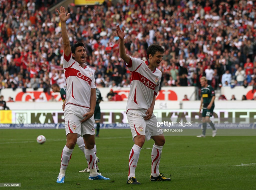 Ciprian Marica of Stuttgart (L) celebrates the seventh goal with Zdravko Kuzmanovic of Stuttgart during the Bundesliga match between VfB Stuttgart and Borussia Moenchengladbach at Mercedes-Benz Arena on September 18, 2010 in Stuttgart, Germany.