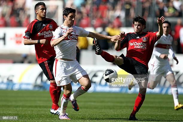 Ciprian Marica of Stuttgart is challenged by Arturo Vidal and Tranquillo Barnetta of Leverkusen during the Bundesliga match between VfB Stuttgart and...
