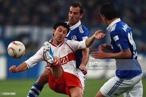 Ciprian Marica of Stuttgart is challenged by Christoph Metzelder and Christoph Moritz of Schalke during the Bundesliga match between FC Schalke 04...