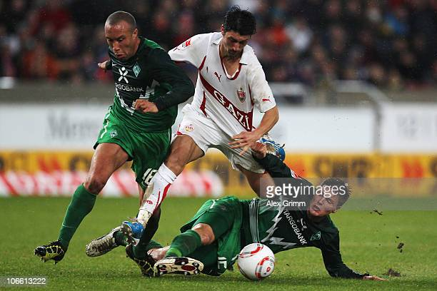 Ciprian Marica of Stuttgart is challenged by Mikael Silvestre and Sebastian Proedl of Bremen during the Bundesliga match between VfB Stuttgart and SV...