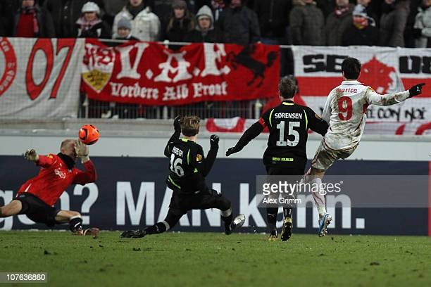 Ciprian Marica of Stuttgart scores his team's fifth goal during the UEFA Europa League group H match between VfB Stuttgart and Odense Boldklub at...
