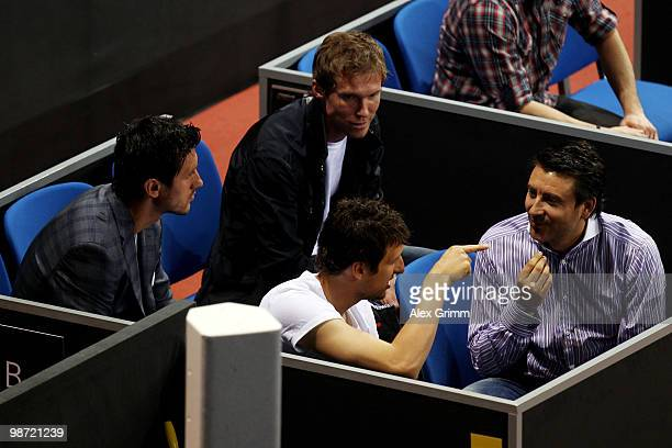 Ciprian Marica Zdravko Kuzmanovic and Aliaksandr Hleb of VfB Stuttgart watch the first round match between Victoria Azarenka of Belarus and Flavia...