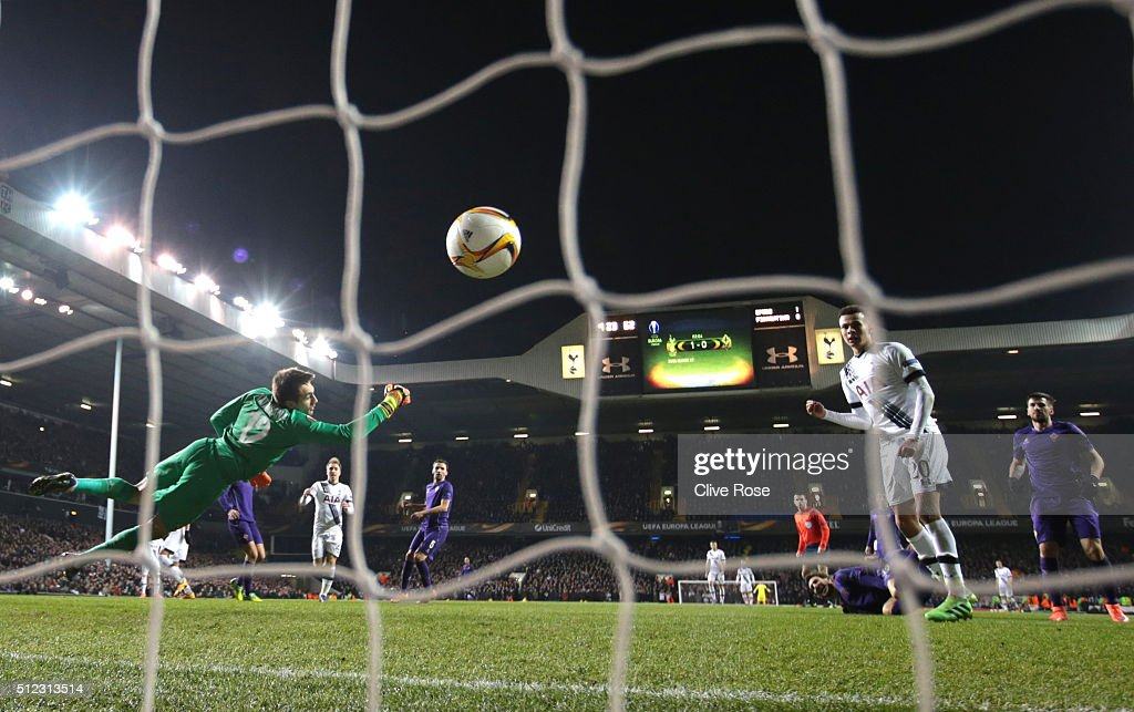 Ciprian Tatarusanu of Fiorentina dives in vain as Erik Lamela of Tottenham Hotspur scores his team's second goal during the UEFA Europa League round of 32 second leg match between Tottenham Hotspur and Fiorentina at White Hart Lane on February 25, 2016 in London, United Kingdom.