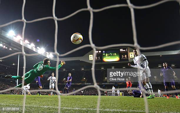 Ciprian Tatarusanu of Fiorentina dives in vain as Erik Lamela of Tottenham Hotspur scores his team's second goal during the UEFA Europa League round...