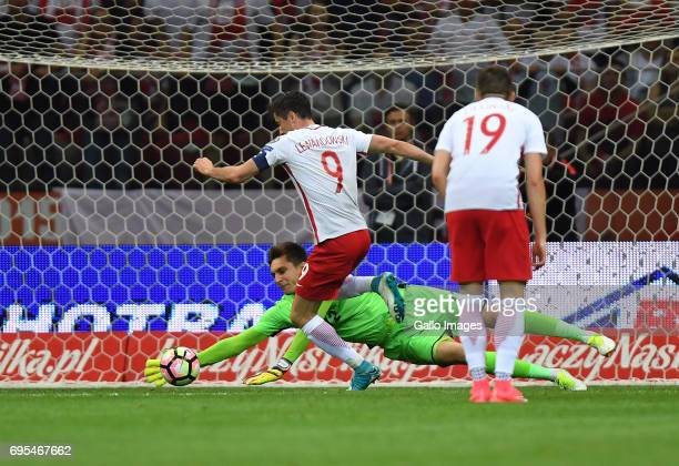 Ciprian Tatarusanu of Romania saves the Robert Lewandowski of Poland shot during the 2018 FIFA World Cup Russia eliminations match between Poland and...