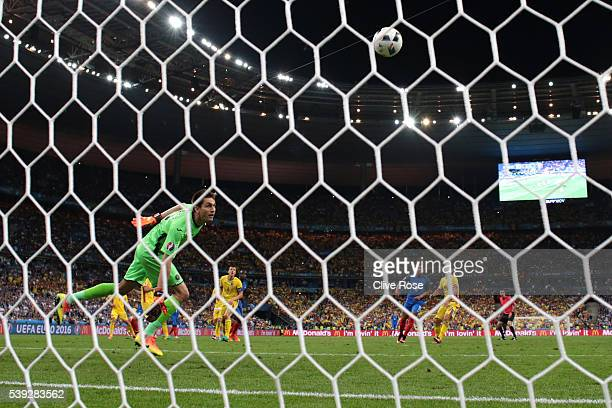 Ciprian Tatarusanu of Romania watches the ball as Dimitri Payet of France scores his team's second goal during the UEFA Euro 2016 Group A match...