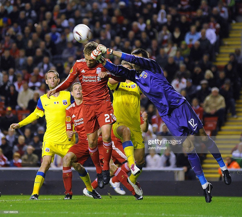 Ciprian Tatarusanu the Steau Bucharest goalkeeper saves the header from Liverpool's Lucas during the first leg UEFA Europa League match between Liverpool and Steau Bucharest on September 16, 2010 in Liverpool, England.