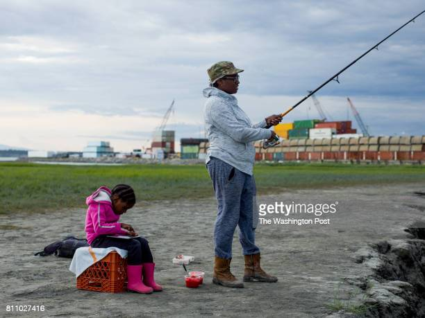ANCHORAGE ALASKA THURSDAY JULY 6 2017 Cipriana Williams fishes in the evening at high tide at Ship Creek with her neice Yukari Williams 5 She says...