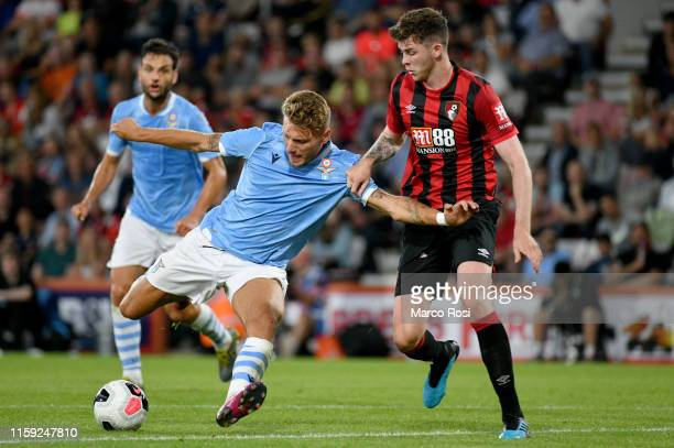 Cir Immobile of SS lazio compete for the ball with Jack Simpson of AFC Bournemouth during the Pre-Season Friendly match between AFC Bournemouth and...