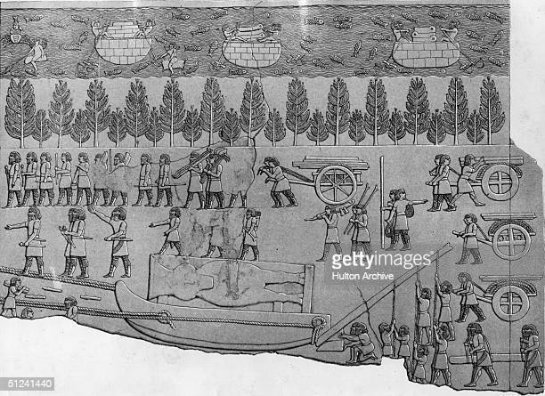 Circa 1000 BC Ancient Assyrian builders moving the statue of a colossal winged bull on a sledge On the River Tigris men row boats ladden with cargo...
