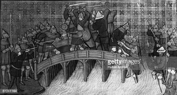 Circa 1380 Armoured soldiers fighting on a bridge during the Hundred Years War