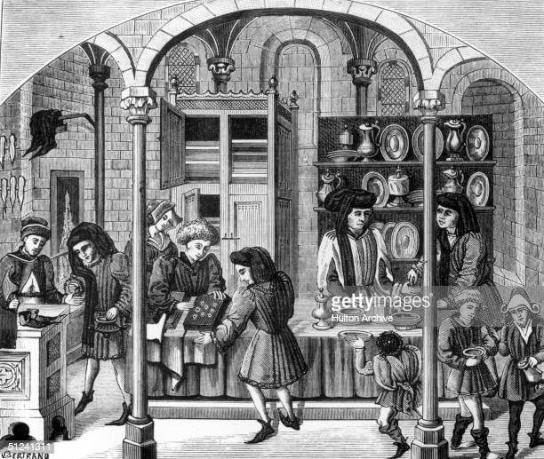 Circa 1400, A medieval covered market. Amongst the products on sale are shoes and tableware. Original Artwork: Engraving by Bertrand