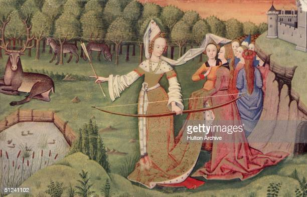 Circa 1450, A group of ladies in the grounds of a castle watching one of their number as she prepares to shoot a stag with a bow and arrow.