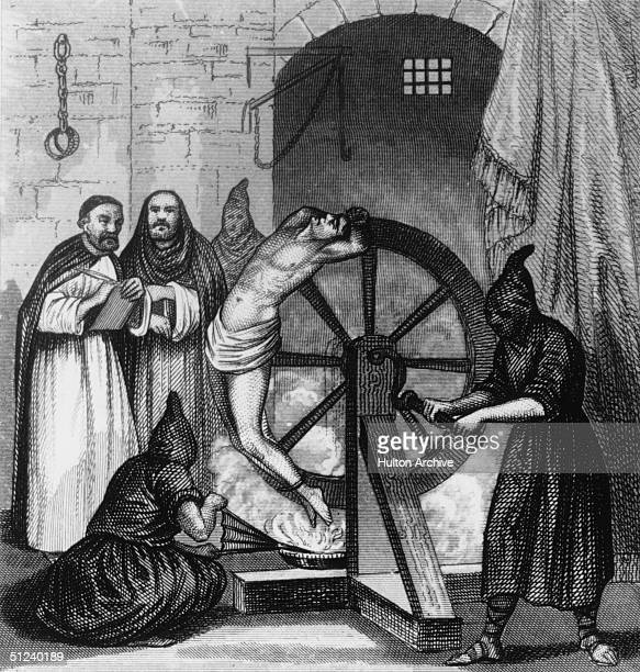 Circa 1500, A prisoner undergoing torture at the hands of the Spanish Inquisition. He is trapped to a revolving wheel below which a fire is being...