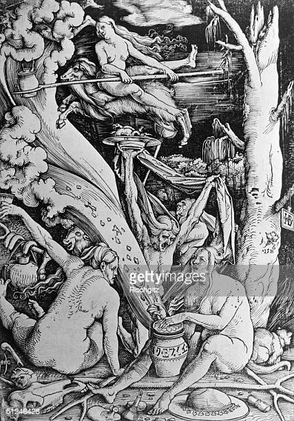 Circa 1500 Mythical witches communing in a woodland landscape One of them flies through the air riding backwards on the back of a goat