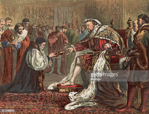 Circa 1535 English Protestant reformer Hugh Latimer presents King Henry VIII with a bible instead of the customary gift of a purse of gold The bible...