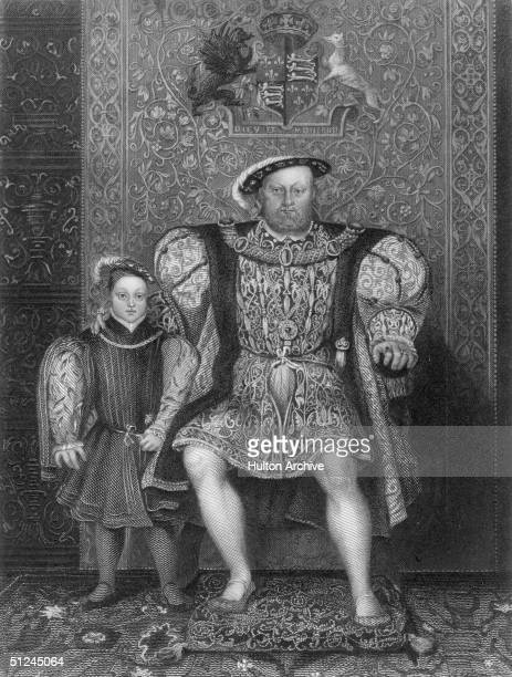 Circa 1547 King of England Henry VIII with Prince Edward his son by his third wife Jane Seymour Above them are the coat of arms of the Tudor royals...
