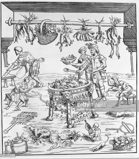 Circa 1549 Cooks preparing a feast in Italian kitchen