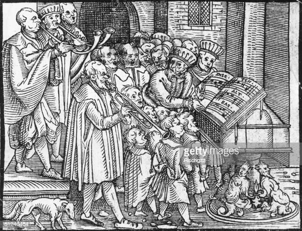 Circa 1550 Tudor musicians in church playing 'brass' instruments