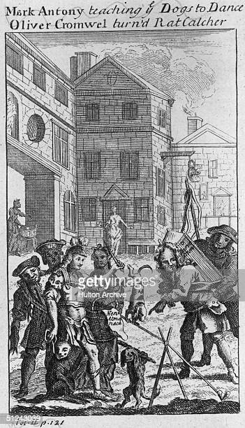 Circa 1655 A group watching performing dogs which are being controlled by a figure in Roman soldier's dress The heading reads 'Mark Antony teaching...
