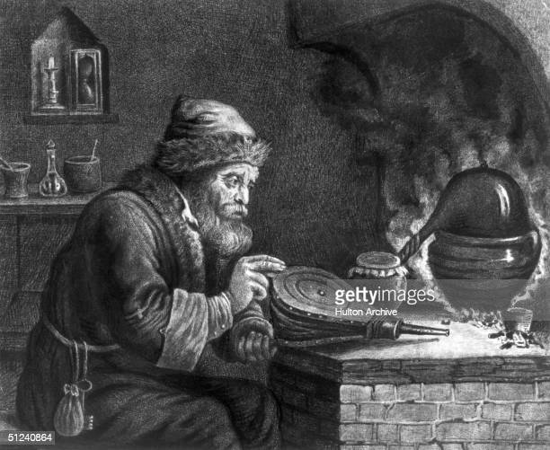 Circa 1660 An alchemist tends a flame with a bellows in his search for the formula of gold Original Artwork Engraving by W Baillie after a painting...