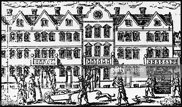 Street scene during the Great Plague of London, which killed 20 per cent of the city's population between 1665 and 1666. Crosses mark the doors of...