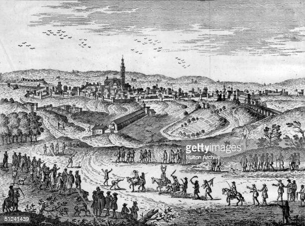 Circa 1700 In the approaches to the city of Seville a man on horseback with antlers on his head is being followed by men with sticks which is the...