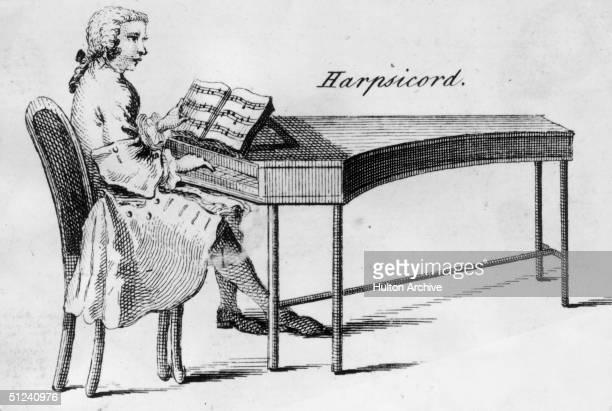 Circa 1750 A man plays a harpsichord