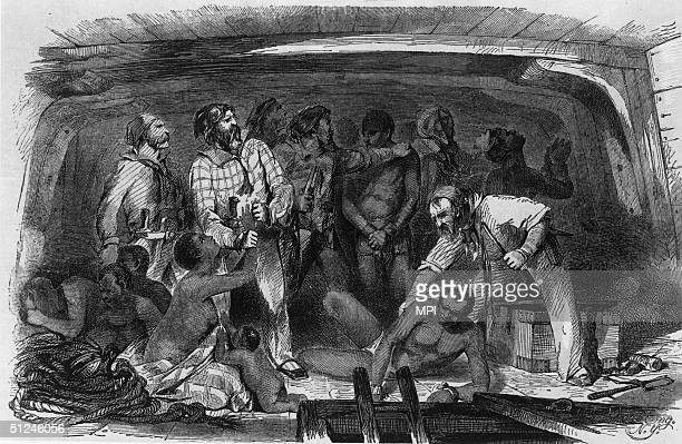 Circa 1750, Cargo is stowed away on a slave ship by night.